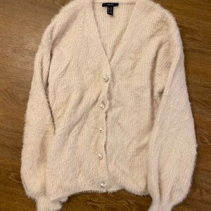 Fuzzy, pearl buttoned sweater